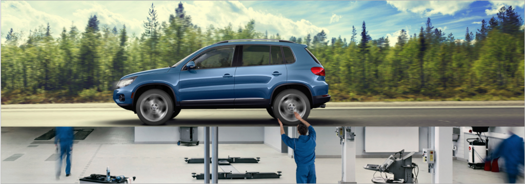 A VW service tech working on a SUV